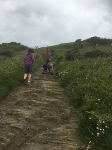 And then up the muddy path, with Carys practicing her rock climbing