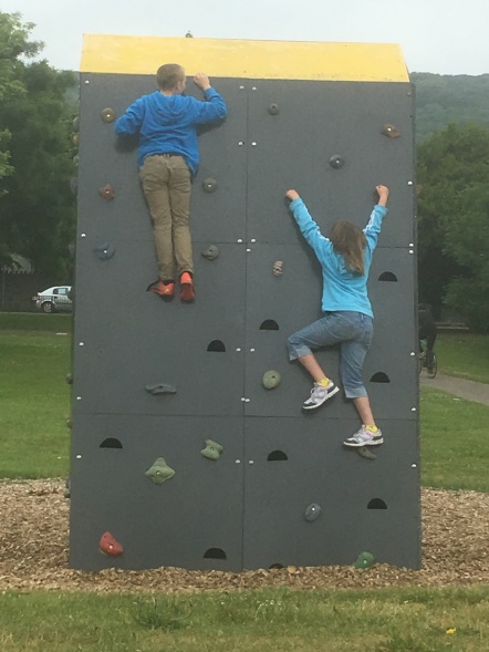 Kids stop on the climbing wall